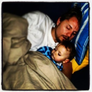 cadel asleep on dad 2