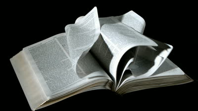bible-pages-turning-in-the-wind-on-black-background-in-slow-motion