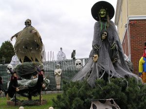 At Halloween, yards and public spaces may be decorated with traditionally macabre symbols including witches, skeletons, cobwebs, and headstones (source; Anthony22 (talk) Transferred from en.wikipedia) http://en.wikipedia.org/wiki/Halloween#mediaviewer/File:Halloween_Witch_2011.JPG