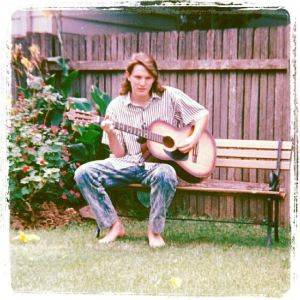 Me and my guitar in 1989. Photo credit: my mum.