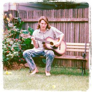 Me and my guitar in 1989. Photo credit: my mum.