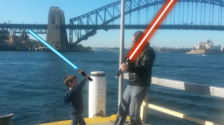 The father/son lightsaber battle on Sydney Harbour. Yes, I *am* wearing a Darth Vader hoodie...