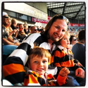 dad and boys wearing tiger jerseys