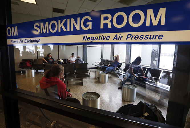Airport smoking room room photo courtesy of Deseret News