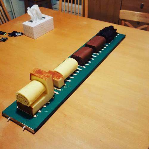 The train cake ready to ice